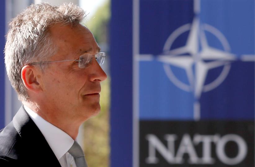 NATO Secretary-General Jens Stoltenberg enters the new NATO headquarters building in Brussels, Belgium, May 7, 2018 (photo credit: FRANCOIS LENOIR / REUTERS)