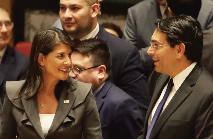 US AMBASSADOR to the UN Nikki Haley speaks with Israeli Ambassador Danny Danon before a Security Council vote on an Arab-backed resolution for protection of Palestinian civilians, at the UN headquarters on Friday. (photo credit: SHANNON STAPLETON/ REUTERS)