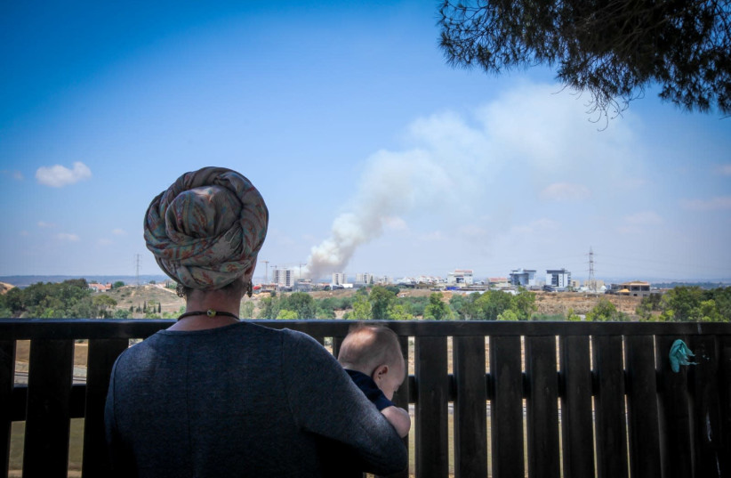 Brushfires rage in southern Israel from incendiary kites launched from Gaza (photo credit: JONATHAN KELLERMAN/TPS)