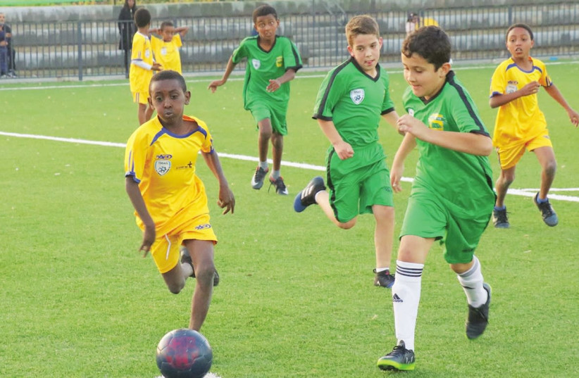 IN ITS ninth year of operation, The Equalizer program brings together Israeli children from different backgrounds through their love of soccer (photo credit: AVIV HAVRON)