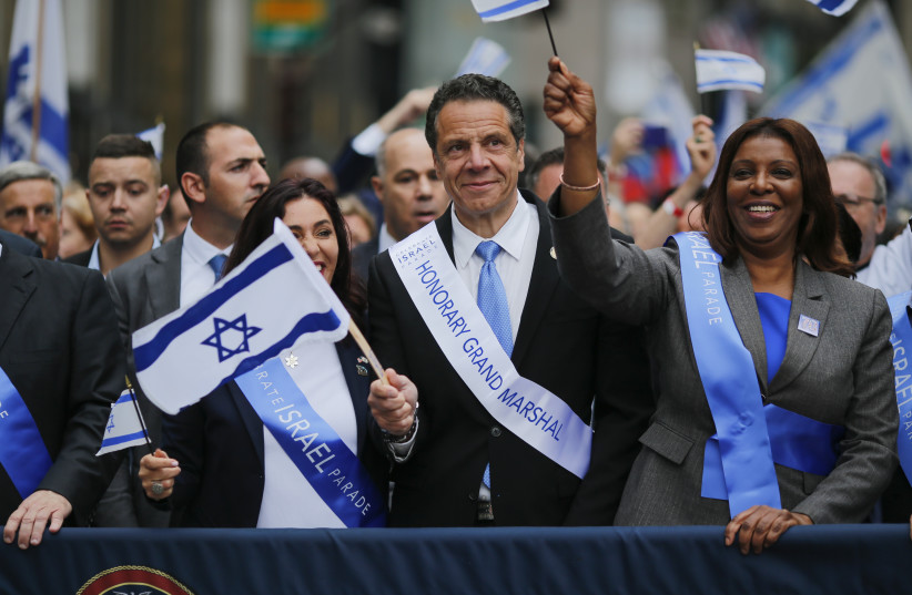 NEW YORK, NY - New York Governor Andrew Cuomo marches during the annual Celebrate Israel Parade on June 3, 2018 in New York City. (photo credit: KENA BETANCUR/GETTY IMAGES/AFP)