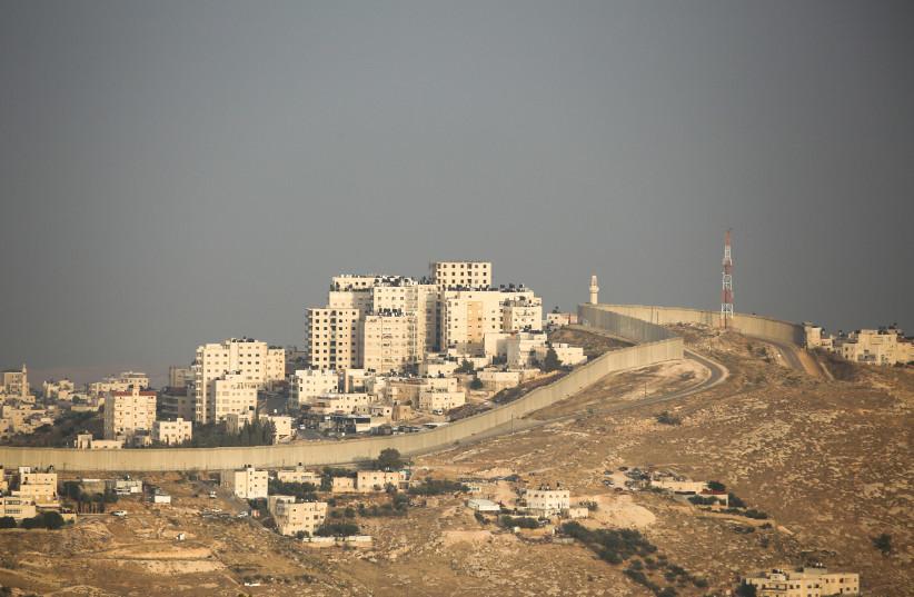 Abu Dis and Wall Seperation  (photo credit: MARC ISRAEL SELLEM)