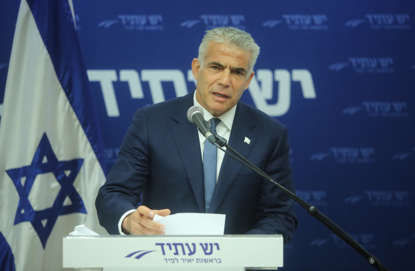 Yesh Atid leader Yair Lapid speaks at the weekly faction meeting at the Knesset (photo credit: MARC ISRAEL SELLEM/THE JERUSALEM POST)