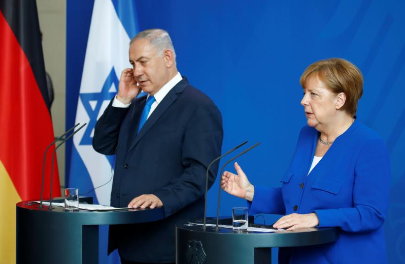 German Chancellor Angela Merkel gestures during a news conference with Israeli Prime Minister Benjamin Netanyahu in Berlin (photo credit: AXEL SCHMIDT/REUTERS)