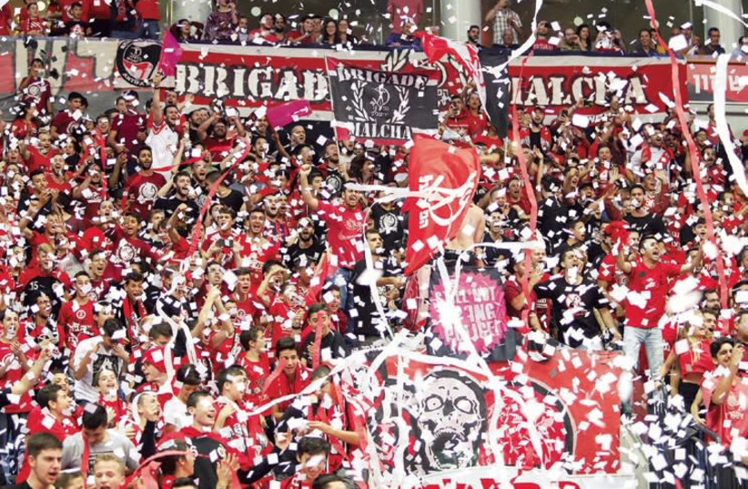 HAPOEL JERUSALEM fans at Malha Arena were thrilled after the Reds pulled out a tight 107-105 victory over Hapoel Gilboa/Galil. (photo credit: DANNY MARON)
