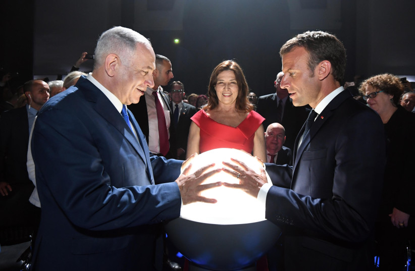 Prime Minister Benjamin Netanyahu with French President Emmanuel Macron at the Paris Grand Palais (photo credit: GPO PHOTO DEPARTMENT)