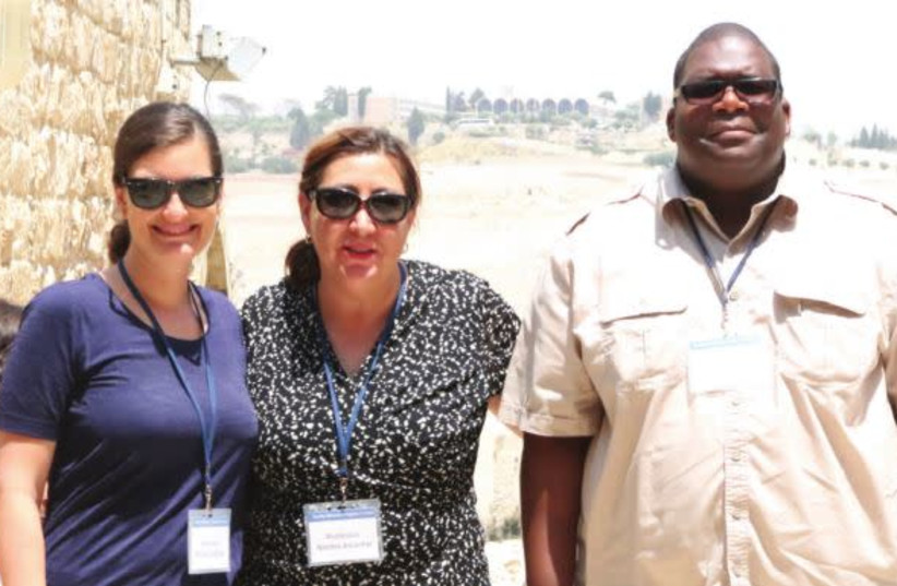 From left to right: Profs. Amalia Leicester, Norma Alcantar and Tyrell Carr pose in Jerusalem's Old City as part of their Faculty Fellowship trip in Israel (photo credit: ERIC NARROW)