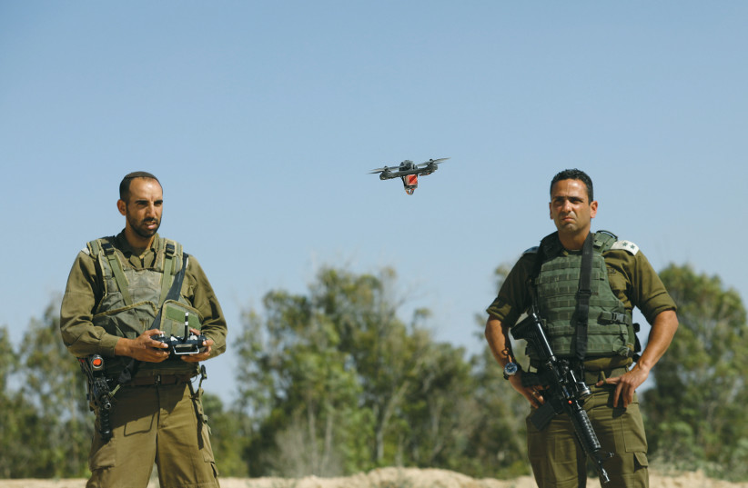 A DRONE FLOWN by IDF soldiers trying to intercept Palestinian kites and balloons loaded with flammable materials, is pictured near Kissufim Tuesday. (photo credit: AMIR COHEN/REUTERS)
