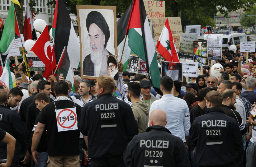 Demonstrators attend an 'al-Quds Day' protest rally in Berlin, Germany, July 11, 2015 (photo credit: FABRIZIO BENSCH / REUTERS)