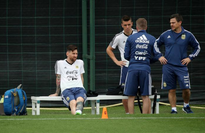 Argentina's Lionel Messi (L) during training for the World Cup, June 2, 2018. (photo credit: ALBERT GEA/ REUTERS)