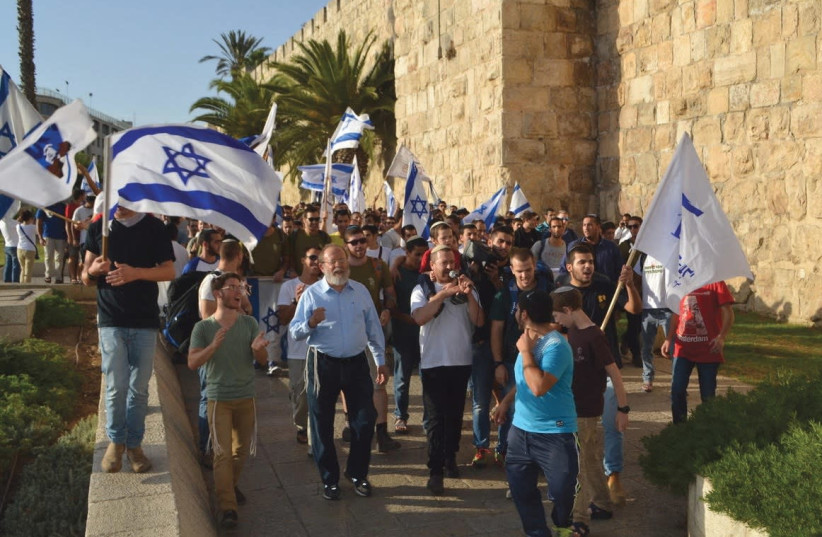 Rabbi Eli Sadan, left, and marching with students outside the Old City in Jerusalem (photo credit: BARRY DAVIS)