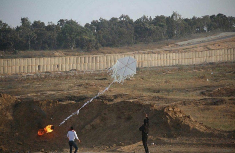 Palestinians in Gaza prepare a kite amid protests at the border fence, June 8, 2018. (photo credit: IDF SPOKESMAN'S UNIT)
