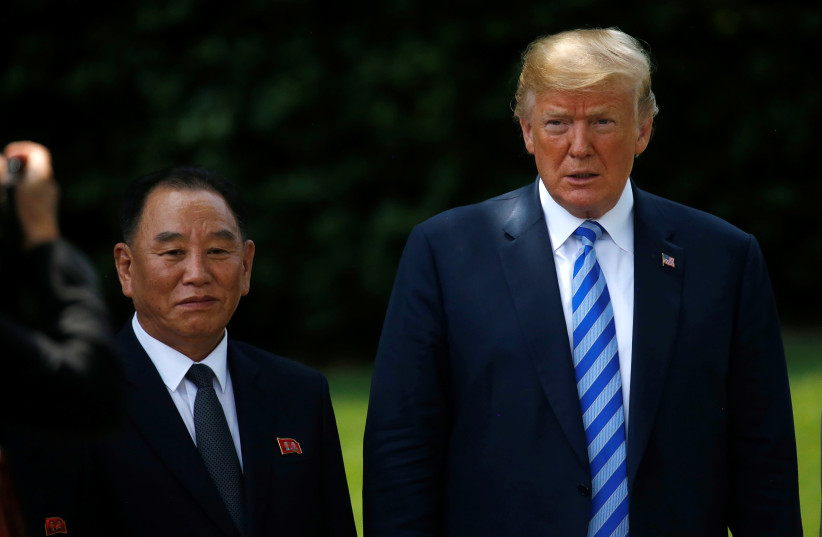 North Korea's envoy Kim Yong Chol poses with US President Donald Trump for a photo as he departs after a meeting at the White House in Washington, US, June 1, 2018 (photo credit: REUTERS/LEAH MILLIS)