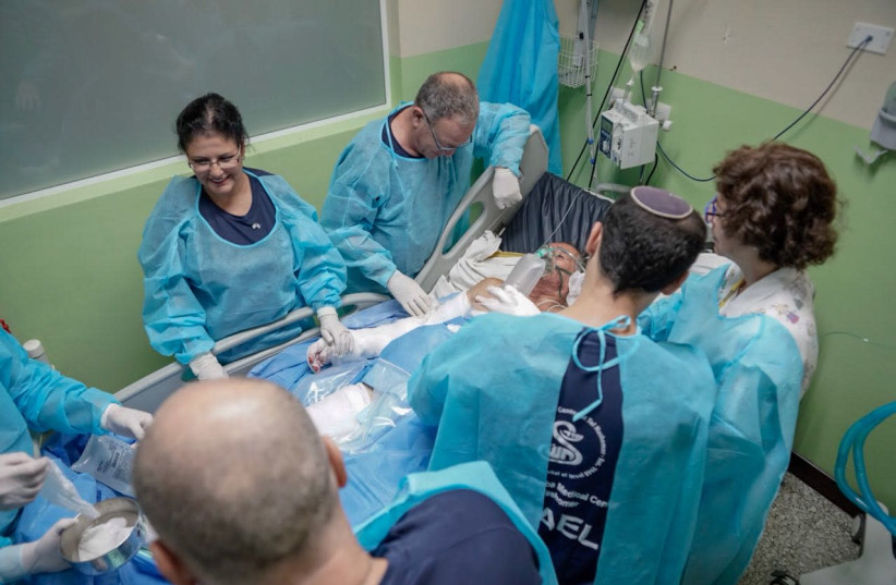 THE ISRAELI medical team in Guatemala treats a patient after volcano erupts (photo credit: FOREIGN MINISTRY)