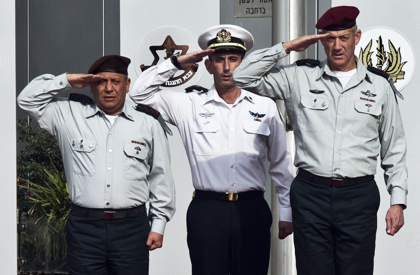 Chief of Staff Lieutenant-General Gadi Eizenkot (L) and outgoing Chief of Staff Lieutenant-General Benny Gantz (R) salute during a handover ceremony at Kirya base in Tel Aviv February 16, 2015 (photo credit: REUTERS/NIR ELIAS)