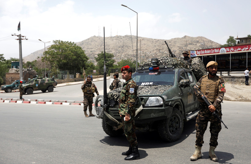 Afghan security forces keep watch at the site of a suicide attack in Kabul, Afghanistan June 4, 2018. (photo credit: OMAR SCOBHANI / REUTERS)
