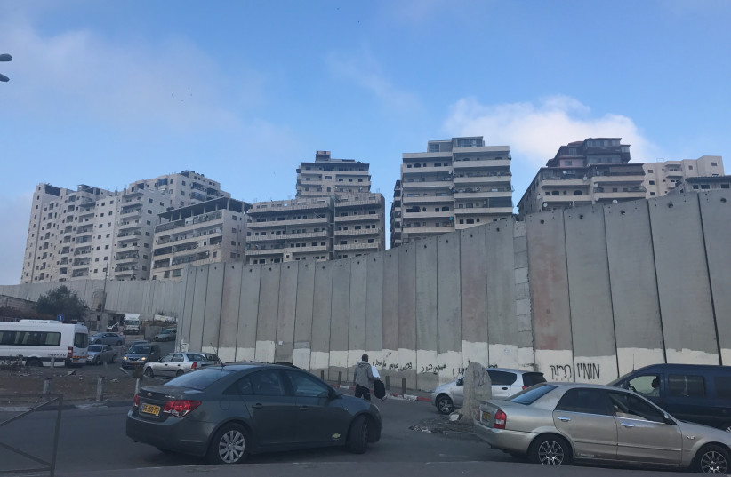 Buildings in Shuafat Refugee Camp, a Jerusalem neighborhood located behind the security barrier that would be affected by Elkin's plan (photo credit: UDI SHAHAM)