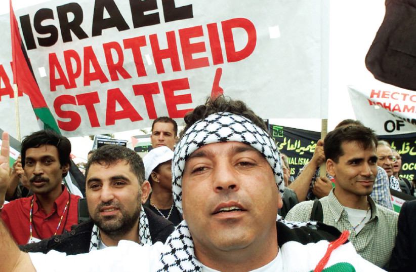 Anti-Israel demonstrators at the World Conference on Racism in Durban, South Africa, in 2001 (photo credit: MIKE HUTCHINGS / REUTERS)