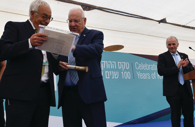 PRESIDENT REUVEN RIVLIN receives as a gift a letter written by his father in 1939 to the head of the university's administration asking for a raise in salary because his wife wasn't working and had just given birth to their first born son whose name was Reuven, at the Hebrew University in Jerusalem  (photo credit: KOBI GIDEON/GPO)