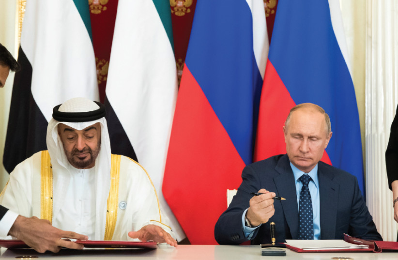 RUSSIAN PRESIDENT Vladimir Putin (seated, right) and Abu Dhabi's Crown Prince Sheikh Mohammed bin Zayed al- Nahyan (seated, left) attend a signing ceremony following talks at the Kremlin in Moscow on June 1, 2018 (photo credit: REUTERS)