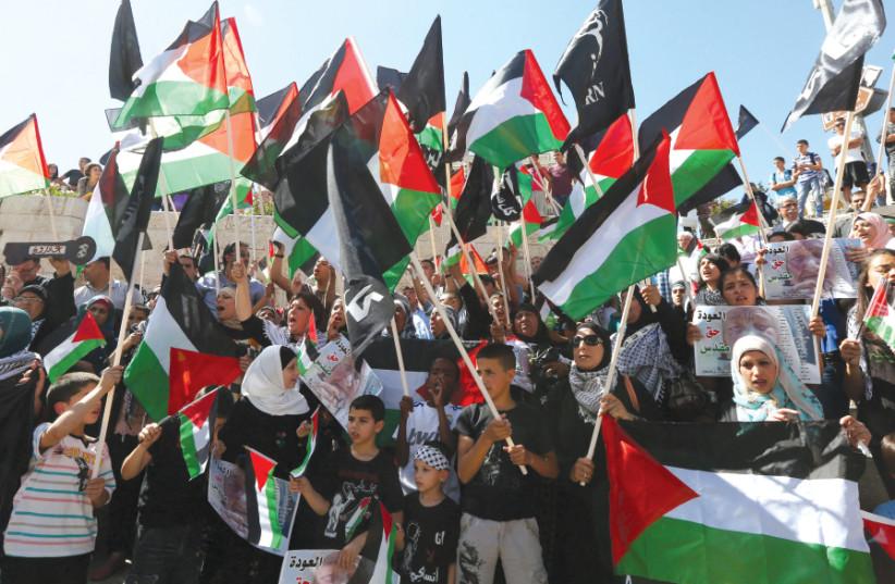 PALESTINIANS CELEBRATE Nakba Day at Jerusalem's Damascus Gate in 2014 (photo credit: MARC ISRAEL SELLEM)