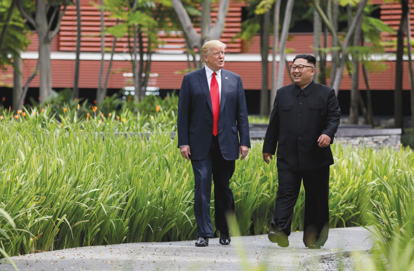 U.S. PRESIDENT Donald Trump and North Korea's leader Kim Jong Un walk together in Sentosa, Singapore in June, 2018 (photo credit: JONATHAN ERNST / REUTERS)