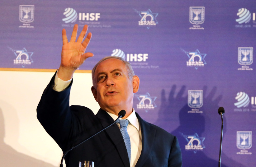 Prime Minister Benjamin Netanyahu gestures as he speaks during the International Homeland Security Forum conference in Jerusalem (photo credit: AMMAR AWAD / REUTERS)