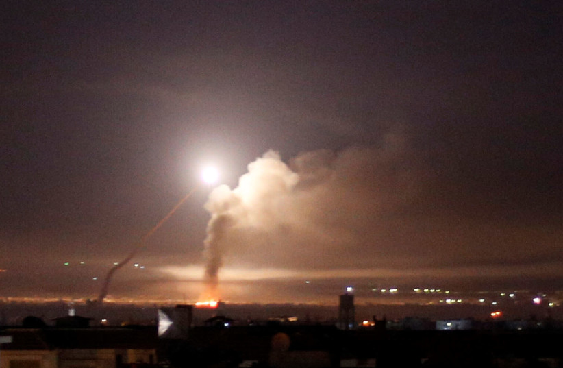Missile fire is seen from Damascus, Syria (photo credit: OMAR SANADIKI/REUTERS)