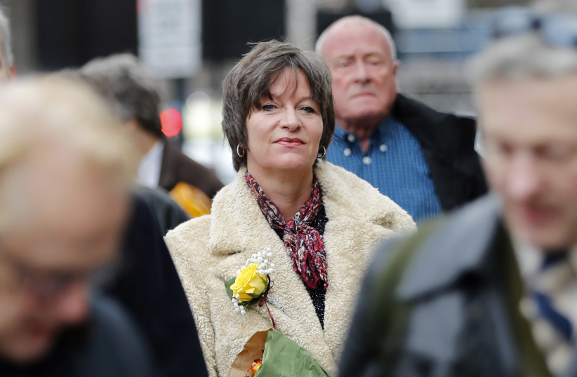 Blogger Alison Chabloz, who is accused of posting anti-semitic songs on her site, arrives at Westminster Magistrate's Court in London on January 10, 2018.  (photo credit: TOLGA AKMEN/AFP)