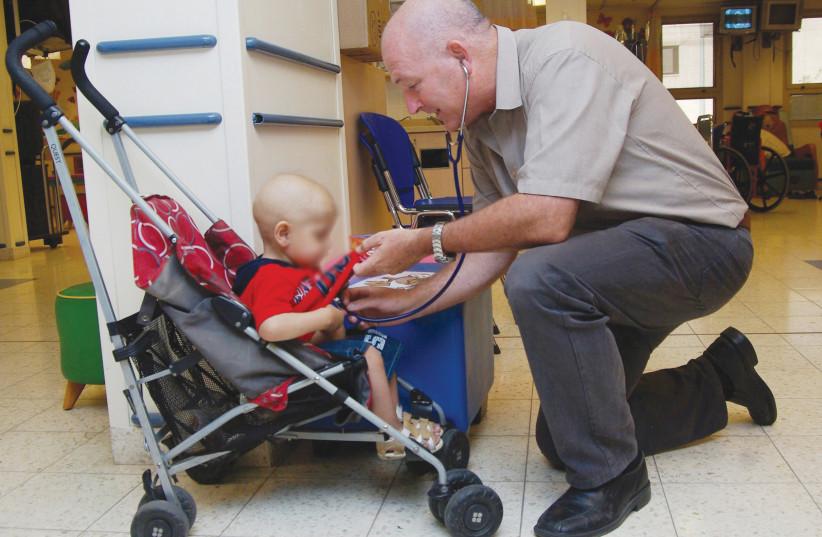 SHEBA MEDICAL CENTER'S Prof. Amos Toren treats a Palestinian child (photo credit: Courtesy)