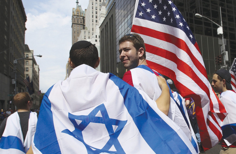AMERICANS TAKE part in the annual Salute to Israel parade in New York City (photo credit: EDUARDO MUNOZ / REUTERS)
