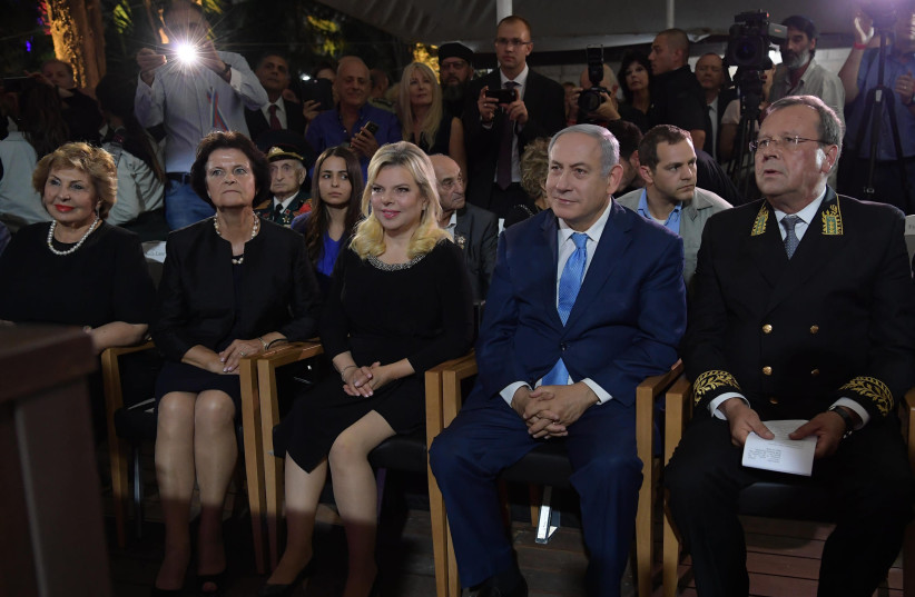 Prime Minister Benjamin Netanyahu and his wife, Sara, attend Russia Day celebrations in Jerusalem, June 14th, 2018 (photo credit: AMOS BEN-GERSHOM/GPO)