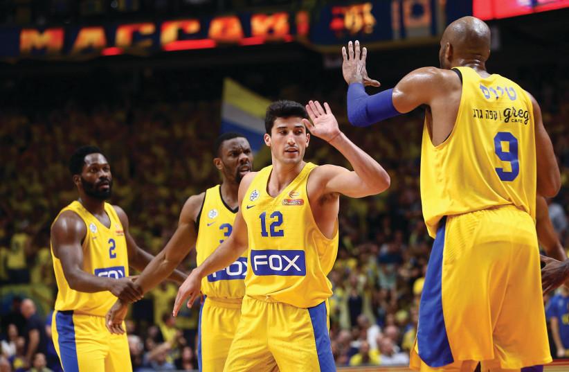 Maccabi Tel Aviv players (photo credit: UDI ZITIAT)