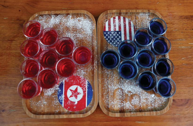 SPECIAL RED AND BLUE shots offered at Escobar bar to mark the summit meeting between Donald Trump and Kim Jong Un are displayed on a table in Singapore last week. (photo credit: EDGAR SU/ REUTERS)