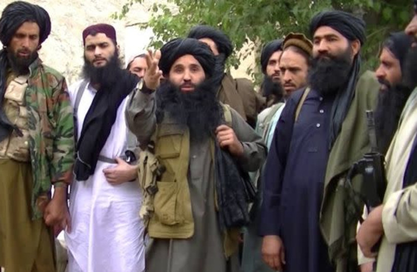 Mullah Fazullah (center) is shown in a video released by the Pakistan Taliban (photo credit: screenshot)