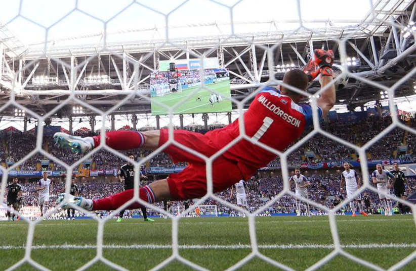 Iceland's Hannes Por Halldorsson saves a penalty from Argentina's Lionel Messi on June 16th, 2018 (photo credit: REUTERS/CARL RECINE)