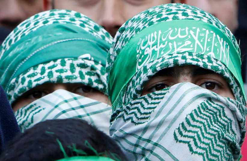 Palestinian Hamas supporters take part in a rally marking the 30th anniversary of Hamas' founding, in the West Bank city of Nablus December 15, (photo credit: ABED OMAR QUSINI/REUTERS)