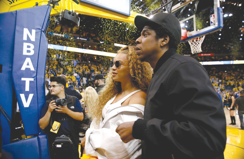 BEYONCE AND Jay-Z  attend the 2018 NBA Playoffs in April. (photo credit: CARY EDMONSON/REUTERS)