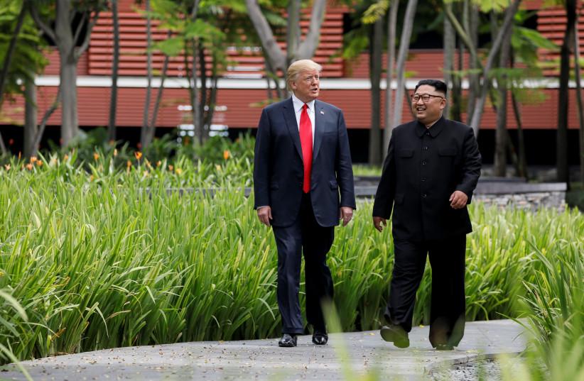US PRESIDENT Donald Trump and North Korean dictator Kim Jong Un enjoy a stroll during their historic meeting. (photo credit: REUTERS)
