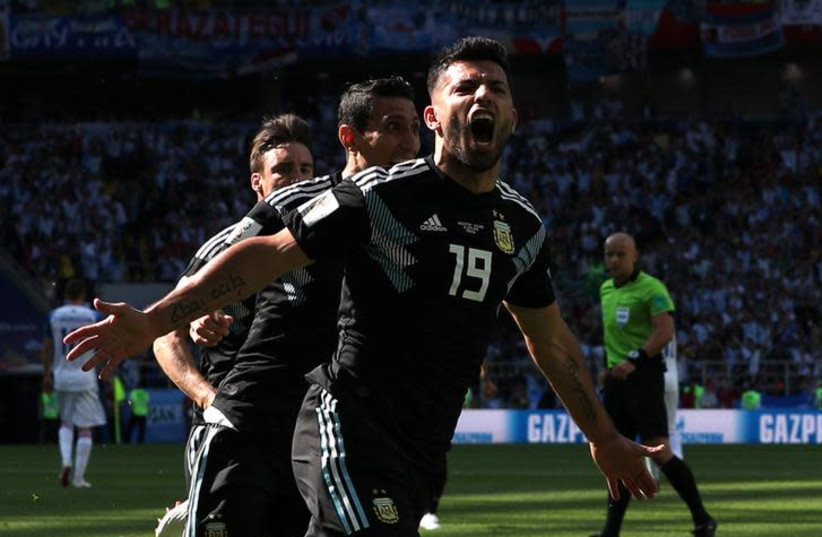 Argentina's Sergio Aguero celebrates scoring the side's first goal in a World Cup match against Iceland, June 16, 2018 (photo credit: ALBERT GEA/ REUTERS)