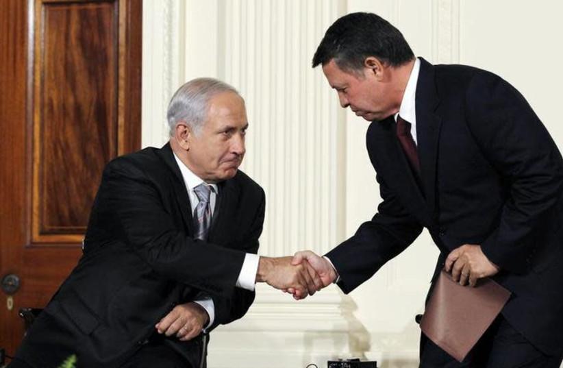 Jordan's King Abdullah II (R) greets Israeli Prime Minister Benjamin Netanyahu in 2010 (photo credit: JASON REED/REUTERS)