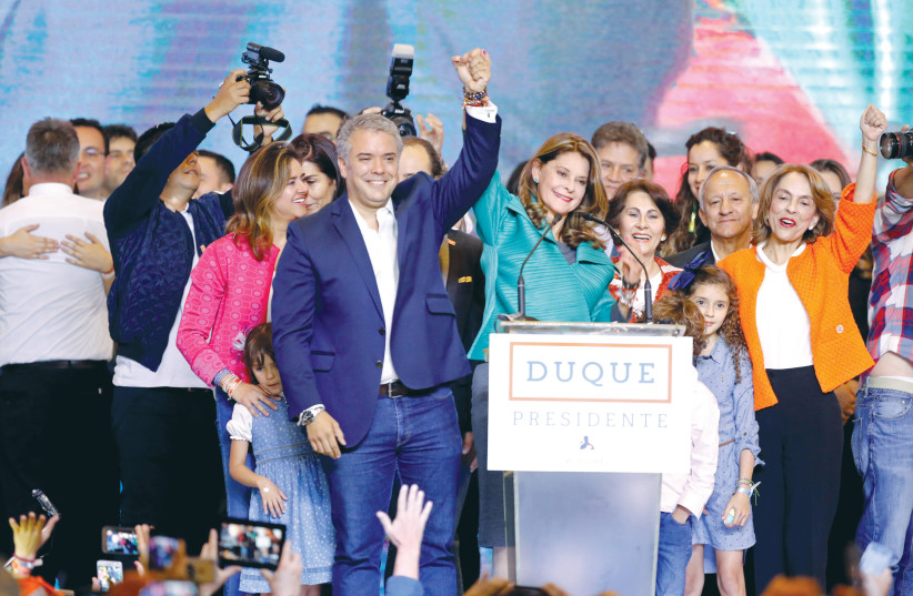 President Ivan Duque and Vice President Marta Lucia Ramirez celebrate after they win the presidential election in Bogota on Sunday (photo credit: ANDRES STAPFF/REUTERS)