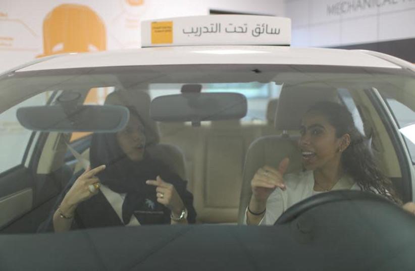 A driving instructor teaches trainee Maria al-Faraj (R) during a driving lesson at Saudi Aramco Driving Center in Dhahran, Saudi Arabia, June 6, 2018 (photo credit: AHMED JADALLAH / REUTERS)