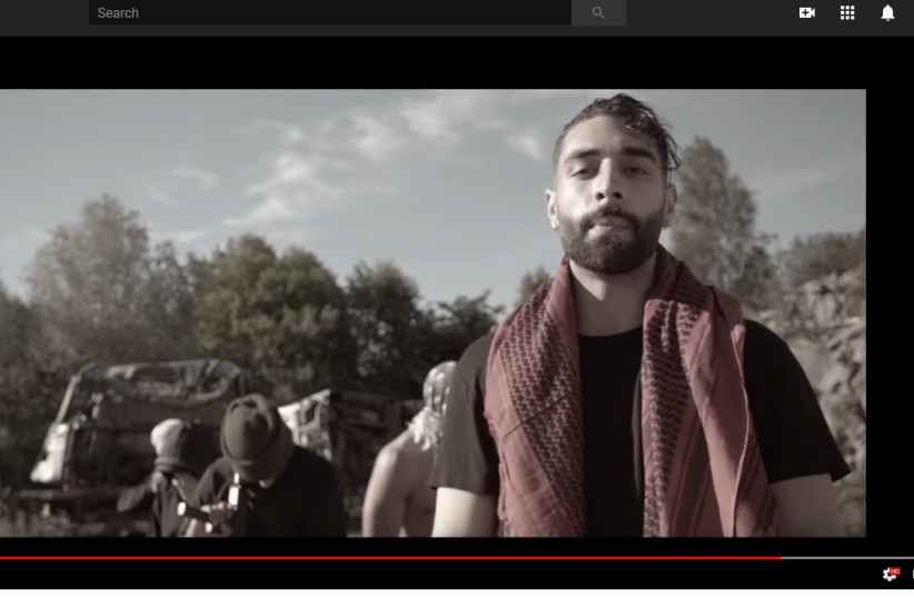 """Kaveh Kholardi in a music video for his song """"The man"""" (photo credit: YOUTUBE SCREENSHOT)"""
