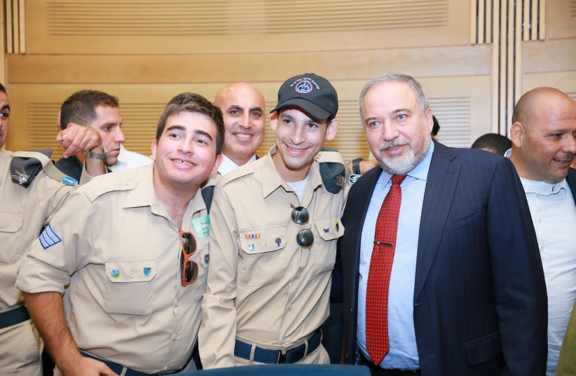 Special in Uniform Salutes the IDF Netanyahu Salutes Special in Uniform, June 19, 2018.  (photo credit: CREDIT-SPECIAL IN UNIFORM JNF)