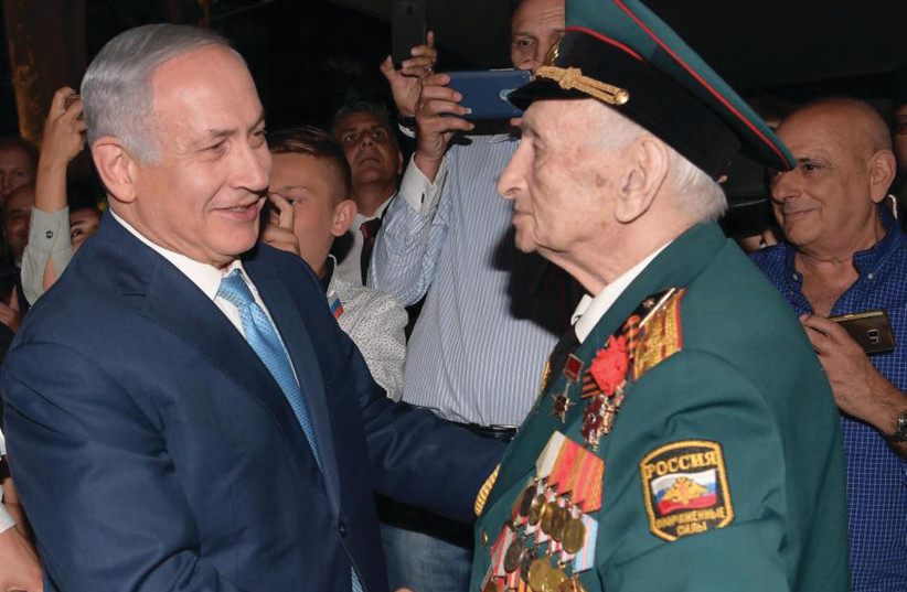 PRIME MINISTER Benjamin Netanyahu greets the bemedaled veteran of the Red Army Emil Zigel on Victory Day.  (photo credit: AMOS BEN-GERSHOM/GPO)