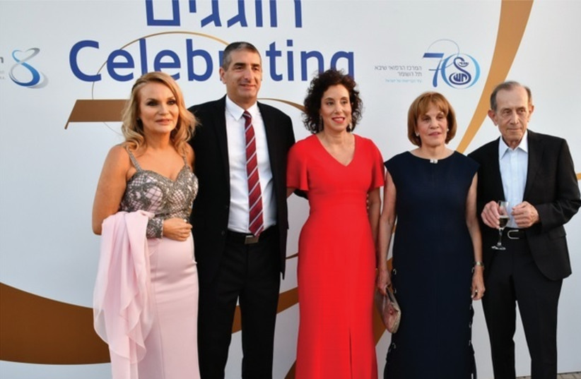 (LEFT TO right) Vered Grinboim, chairwoman, Israel Friends of Sheba; Sheba director-general Yitshak Kreiss and his wife, Inbal; the chairwoman of Sheba's Circle of Friends and her husband, Galia and Yehoshua Maor. (photo credit: AVI HOFI AND RAFI DELOUYA)
