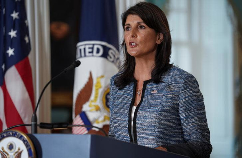 US Ambassador to the United Nations Nikki Haley delivers remarks to the press announcing the US's withdrawal from the UN's Human Rights Council at the Department of State in Washington, US, June 19, 2018 (photo credit: TOYA SARNO JORDAN / REUTERS)