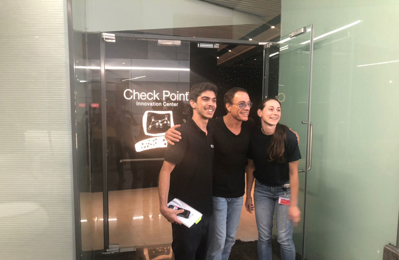 Jean Claude Van Damme (C) poses for a photo at Check Point in Tel Aviv, June 20th, 2018 (photo credit: COURTESY CHECK POINT)