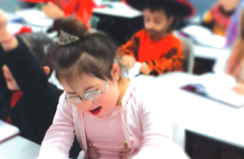 HALLEL, EIGHT, who has Down syndrome and is part of the inclusive education system, reads a 'pasuk' on Purim (photo credit: COURTESY HALLEL'S PARENTS)